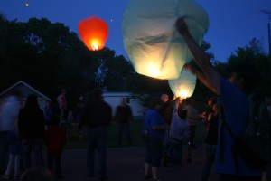 David Losure, right, holds up a sky lantern during Finn Fest in Frederick, S.D., June 15, 2013.