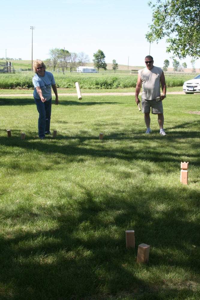 Sheryl and Rick Downes play kubb, a strategy stick-tossing game, during Finn Fest in Frederick, S.D., June 15, 2013.