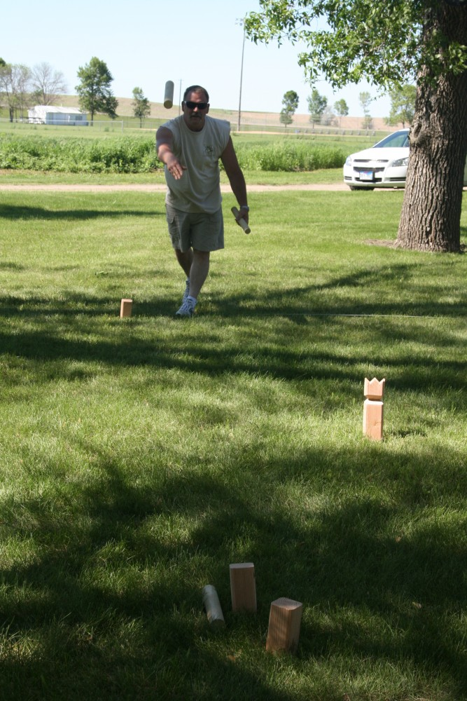 Rick Downes plays kubb, a strategy stick-tossing game, during Finn Fest in Frederick, S.D., June 15, 2013.
