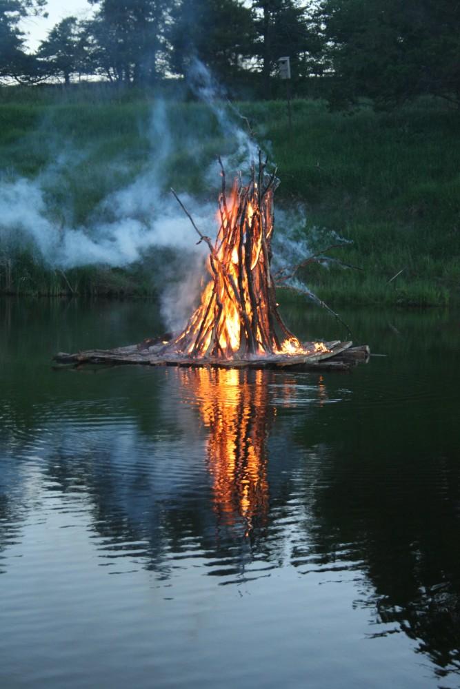The juhannuskokko, or midsummer bonfire, burned with a lot of smoke during the Finn Fest celebration in Frederick on June 15, 2013.