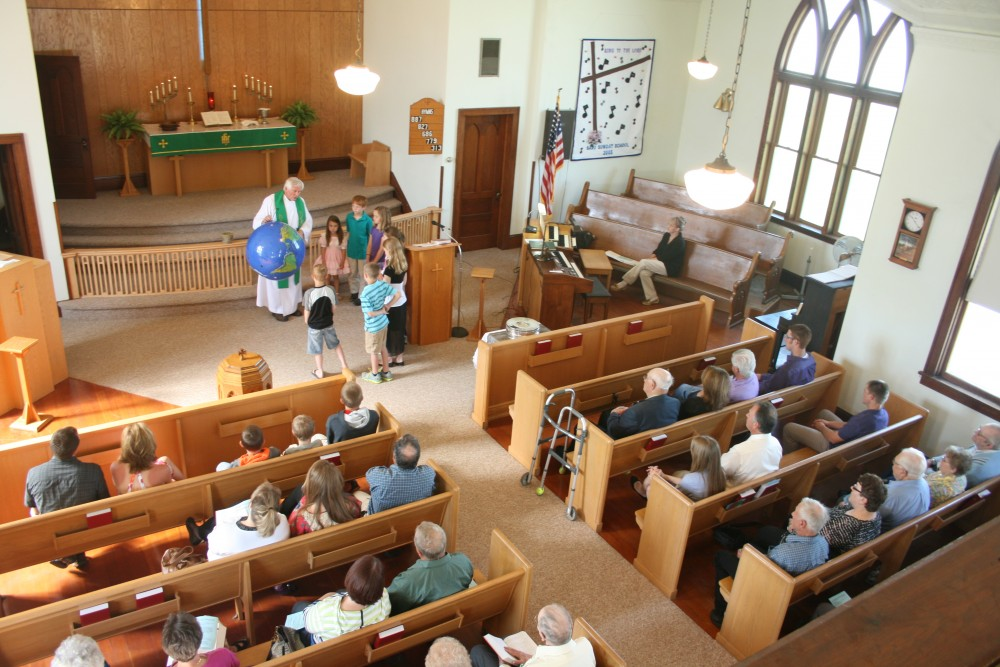 The Rev. Galen Sylvester gives the children's sermon during the Finn Fest worship service at Savo Lutheran Church in rural Frederick on June 16, 2013.