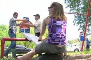 wife carrying winner weighing beer on teeter totter