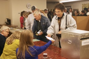 Rayma and Jack Smith were the first two voters through the line as polls opened at 7 p.m. on Oct. 16. One hundred twenty-two people voted on the fire district, either in person or by absentee ballot. At times, the line was out the door. Photo by Heidi Marttila-Losure