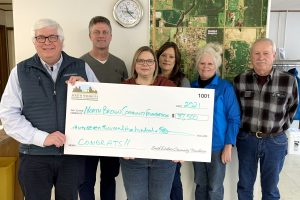 Pat Gallagher, left, of the South Dakota Community Foundation, presents a check for $37,500 to board members of the North Brown Community Foundation: Scott Campbell, Heidi Marttila-Losure, Melissa Ellwein, Gayle Bakeberg, and Lyle Podoll.